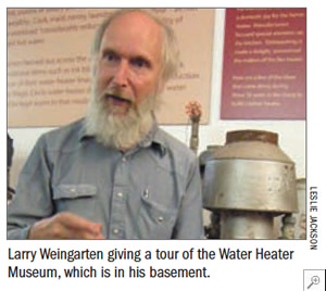 Larry Weingarten giving a tour of the Water Heater Museum, which is in his basement.